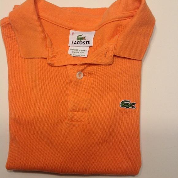 f5f41c560c31 Lacoste Other - Unisex kids Lacoste orange polo shirt